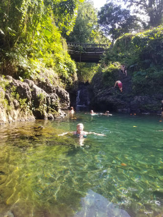 Swimming in fresh waterfall pool of Ching''s Pond on Road to Hana!