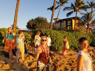 Dance traditional hula on beach with a flower release at sunset!